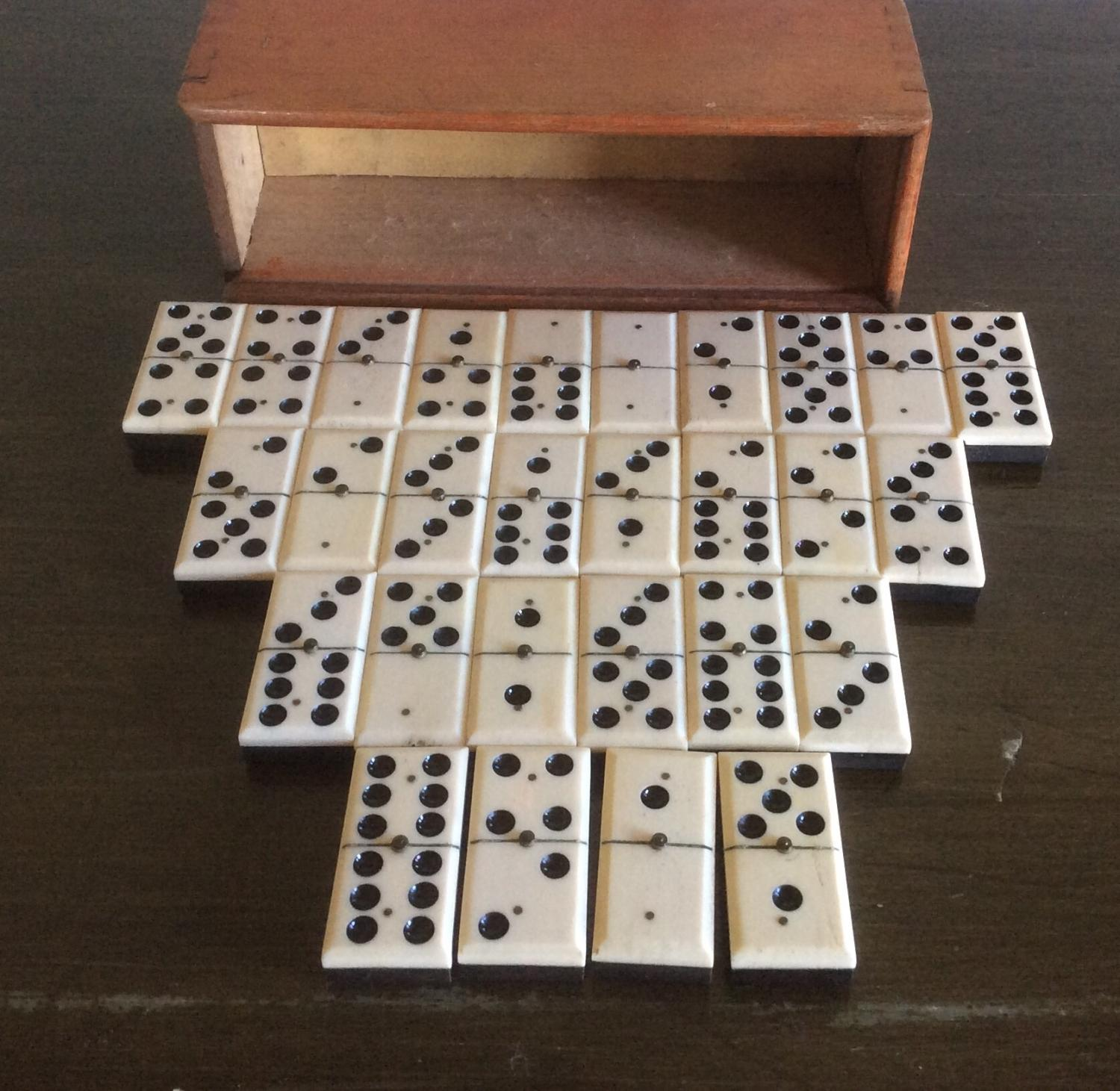 Standard studded Bone and Ebony Dominoes