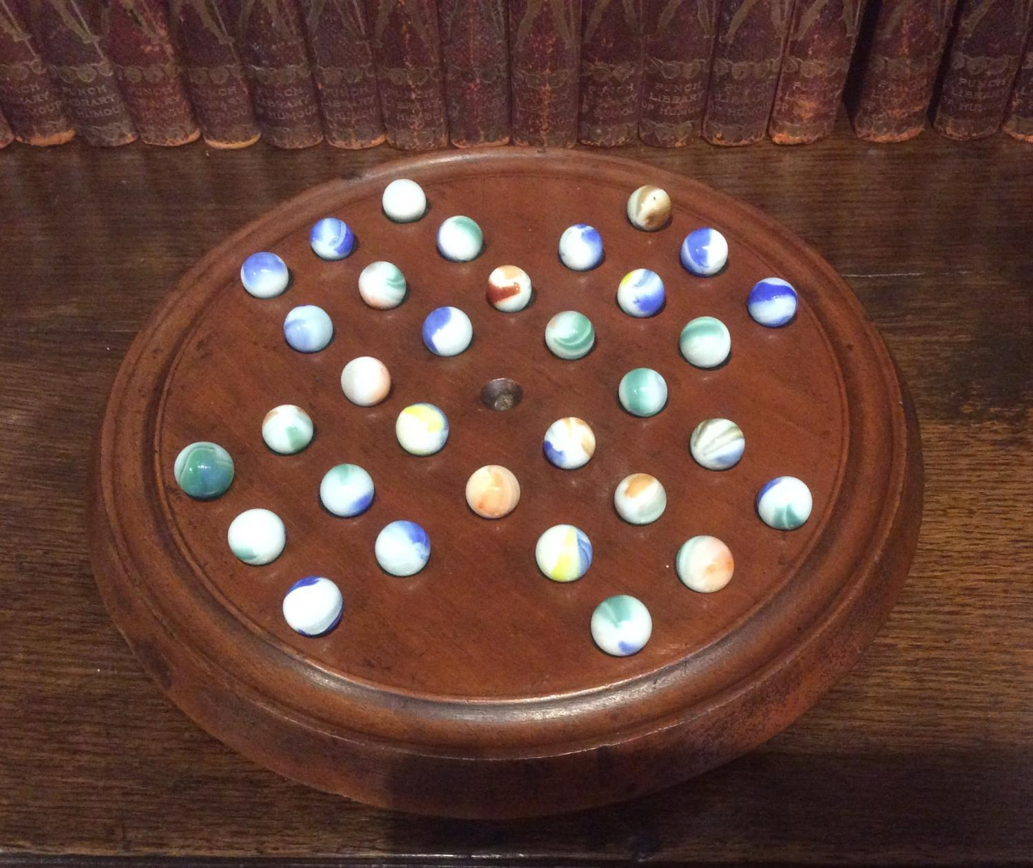 Solitaire Board Game with Marbles