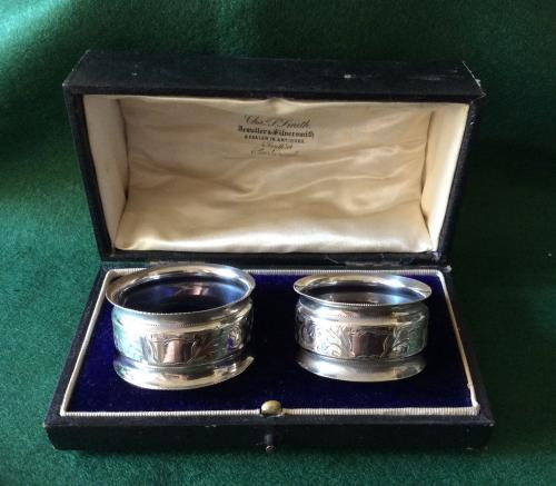 Pair of silver napkin rings by A.H Arthur Har